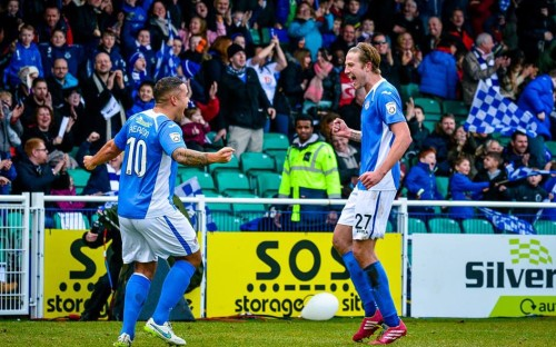 Pell and Reason celebrate Eastleigh opening the scoring against Macclesfield.